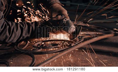 Close up of man's hands smoothing metal grate