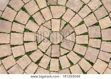 Stone paving circle texture. Abstract structured background of modern street pavement slabs pattern