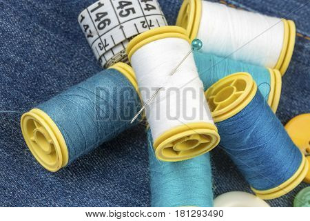 Colorful thread reels, bobbins and pins for sewing