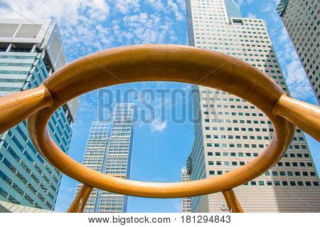 SINGAPORE - MAR 21 2017 : Bottom view of fountain of wealth at Suntect City. Suntec City is the largest fountain in the world with a golden ring in the side of fountain the city at Singapore.