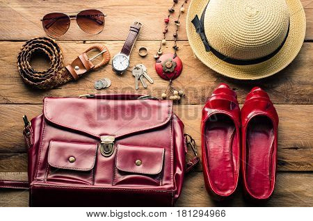 Clothing and accessories for women on wood floor for travel at holiday