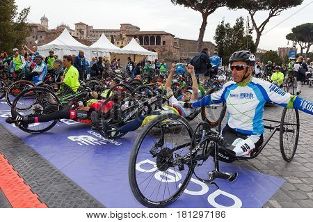 Rome Italy - April 2nd 2017: Athletes with hand bikes are prepared before departure at the 23rd Marathon of Rome in Via dei Fori Imperiali.