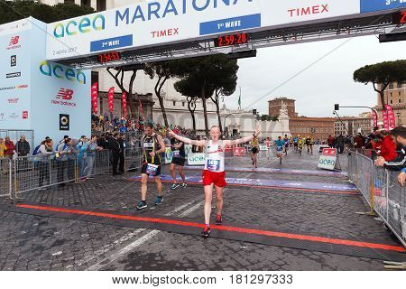 Rome Italy - April 2nd 2017: Athletes participating in the 23rd Rome Marathon exhausted reach the finish line in Via dei Fori Imperiali.