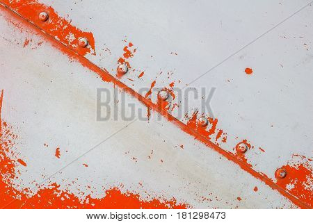iron surface is covered with orange and grey color remnants of old paint, texture background
