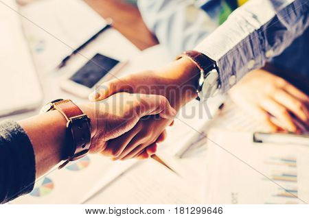 Handshake between joint venture business businessman's handshake. Successful businessmen handshaking