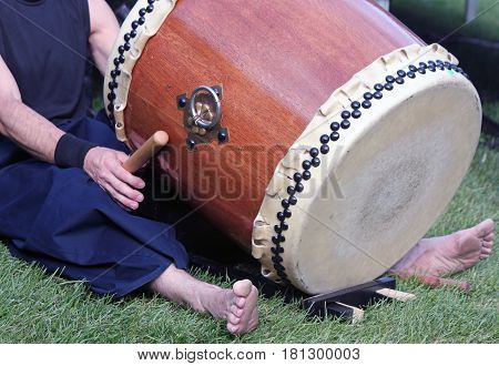Closeup of a Japanese Taiko Drummer Sitting with Drum