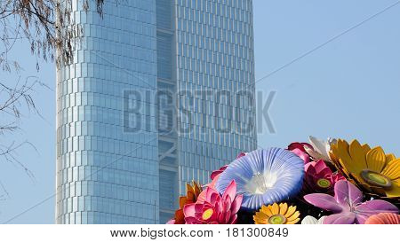 A flower sculpture display near a modern office building in the city of Nanjing China in Jiangsu province.