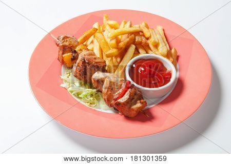 Meat Skewer With French Fries On White Background