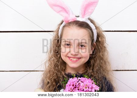 Happy Girl In Easter Bunny Ears With Pink Flower Bouquet