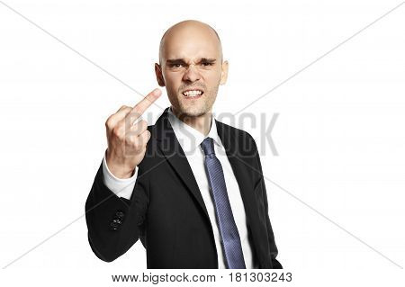 Portrait of young man shows fuck you with hand. Studio shot. Isolated on white background.
