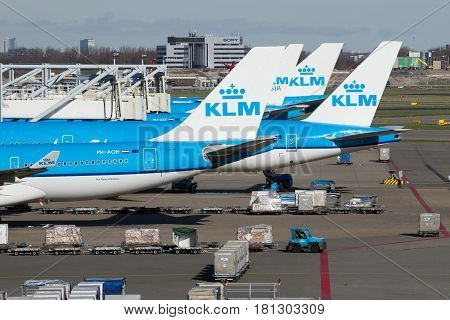 AMSTERDAM-SCHIPHOL - FEB 16 2016: KLM Boeing aircraft on the tarmac of Schiphol airport.