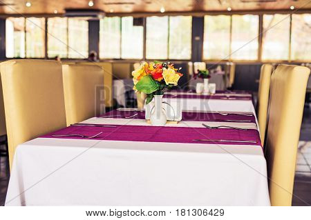 Close up Elegant Tabletop Setting Design for Four People Inside an Expensive Restaurant.