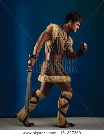 The attractive caveman is ready for war.