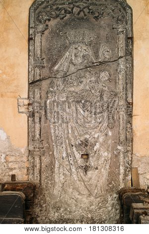 Riga, Latvia. Doorside Stone From The Blackheads House With The Relief Of St Mary In Museum Of Dome Cathedral