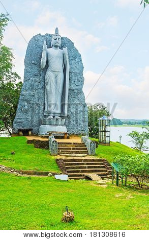 The Statue Of Buddha At The Lake
