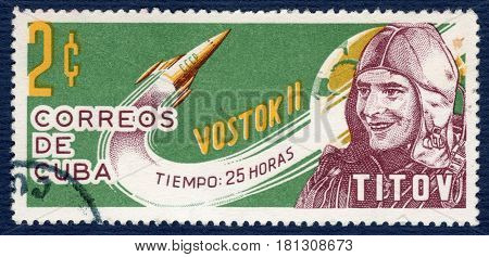 CUBA - CIRCA 1963: Postage stamp printed in USSR shows portrait of cosmonaut German Titov, spacecraft-satellite