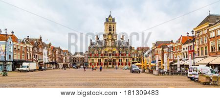 Delft, Netherlands - April 6, 2016: Stadhuis or City Hall, Markt square panorama with houses, people in Delft, Holland