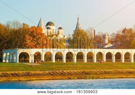 Architecture autumn landscape of Veliky Novgorod Russia- arcade of Yaroslav Courtyard and ancient St Nicholas cathedral in Veliky Novgorod Russia