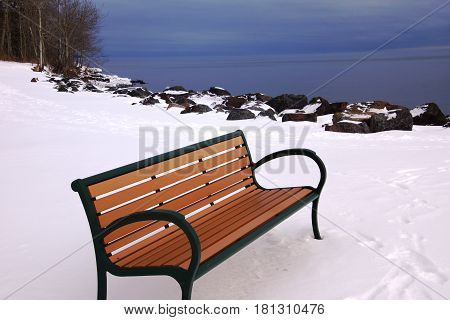 Park bench overlooking the lake in winter