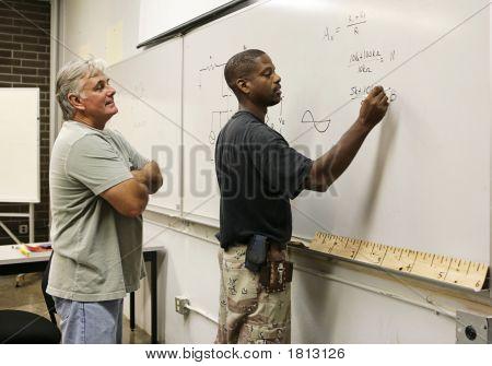 Teacher Watching Student