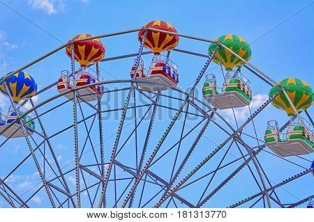 Fragment of Ferris Wheel against the Blue Sky