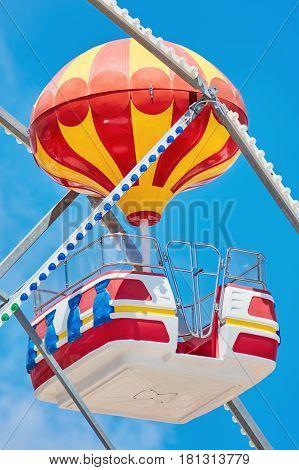 A Ferris Wheel over the Blue Sky