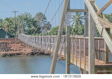 Architectural Elements: architectural elements of the suspension bridge in the historical town of Hanapepe, on Kauai, Hawaii, mid morning, March 28, 2017