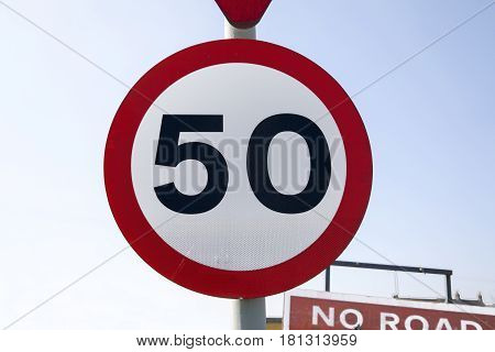 A red and white 50 miles per hour road sign
