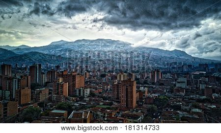 Latin or South American City in the mountains with storm / rain clouds. Medellin Colombia