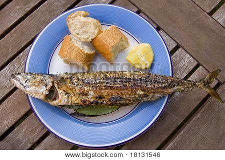Mackerel served with bread and lemon to provide a healthy meal poster