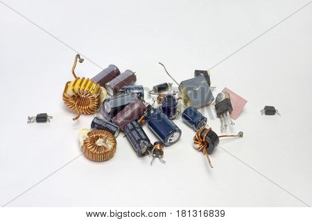 Bunch Of Electronic Parts: Capacitors, Transistors, Inductors With Toroid Core And High-frequency In