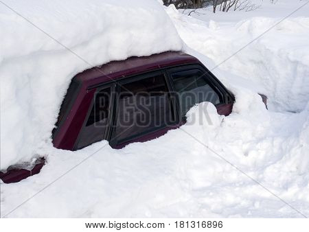 Passenger car drowned in a big snowdrift