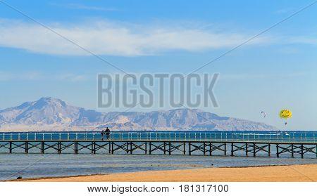 The bridge to the sea , parachute in the air