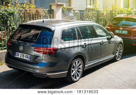 STRASBOURG FRANCE - APR 8 2017: New Volkswagen Passat wagon car parked in central city parking. The Volkswagen emissions scandal (also known as