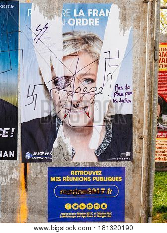STRASBOURG FRANCE - APR 12 2017: Official campaign posters of Marine Le Pen political party leader of Front national (FN) ones of the eleven candidates running in the 2017 French presidential election