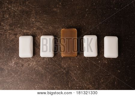 Tar soap and white soap on a dark marble background. Personal Hygiene care.