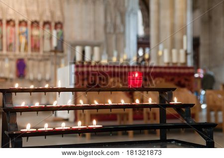 Prayer Candles At The Altar And Nave Of The Church
