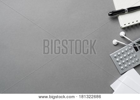 Concept of business still life with office objects on gray surface