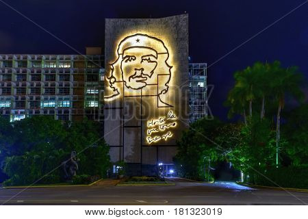 Havana, Cuba - Jan 13, 2017: Portrait of Che Guevara on the Ministry of the Interior by the Plaza de la Revolucion in Havana Cuba at night.