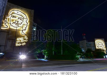 Havana, Cuba - Jan 13, 2017: Portraits of Che Guevara and Camilo Cienfuegos on the Ministry of the Interior and the Ministry of Informatics and Communications by the Plaza de la Revolucion in Havana Cuba at night.