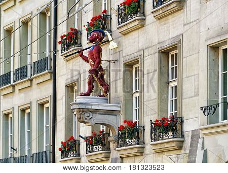 Bern, Switzerland - August 31, 2016: Monkey statue on one of the buildings in Kramgasse street with shopping area in old city center of Bern Switzerland