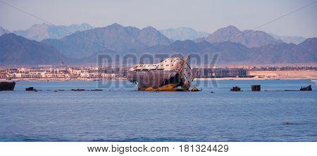 Abandoned broken ship in the sea , landscape