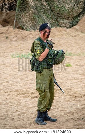 Saint-Petersburg, Russia - August 9,  2015: marine corps officer of the Russian army in a protective camouflage stands on a sandy shore after the assignment exercises