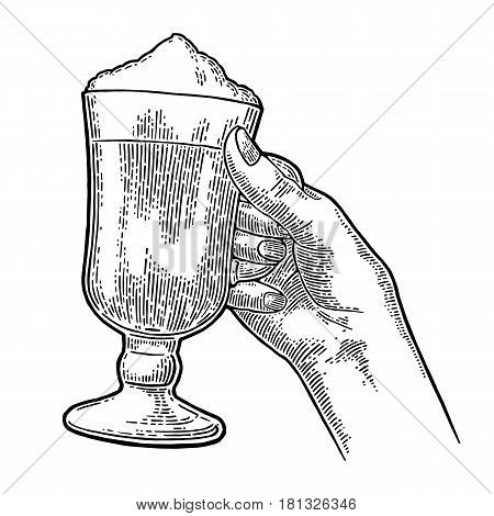 Hand holding a glass of Latte macchiato coffee with whipped cream. Hand drawn sketch style. Vintage black vector engraving illustration for label web flayer. Isolated on white background