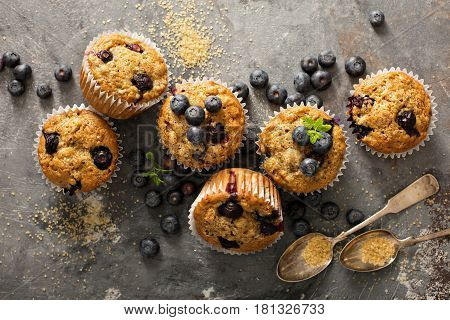 Healthy vegan banana blueberry muffins with fresh berries overhead shot
