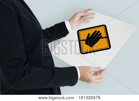Studio Shoot Holding Banner with Don't Touch Caution Sign