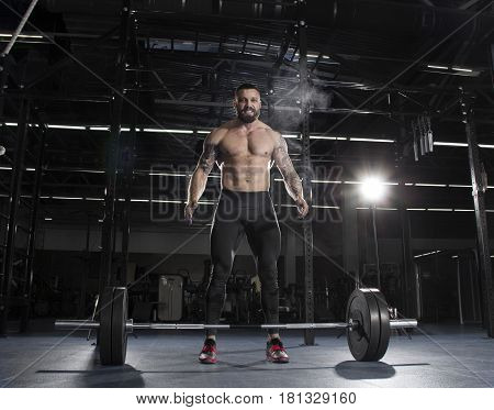 Muscular Shirtless Man Clapping Hands Before The Barbell Workout