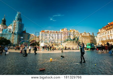 Prague Czech Republic - October 15,  2014: Unidentified young woman makes soap bubbles in Old Town Square Staromestske namesti in Prague Czech Republic