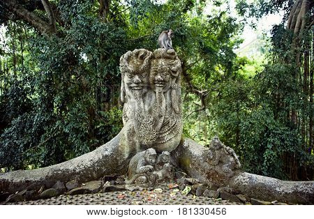 stone sculpture of a group of monkeys live monkey in a tropical forest