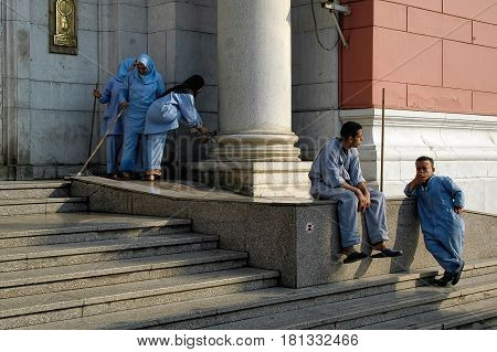 Cairo, Egypt - November 11, 2006: The Egyptian Museum in Cairo, one of the most famous museums of the world. Staff of the museum has a rest on an entrance porch